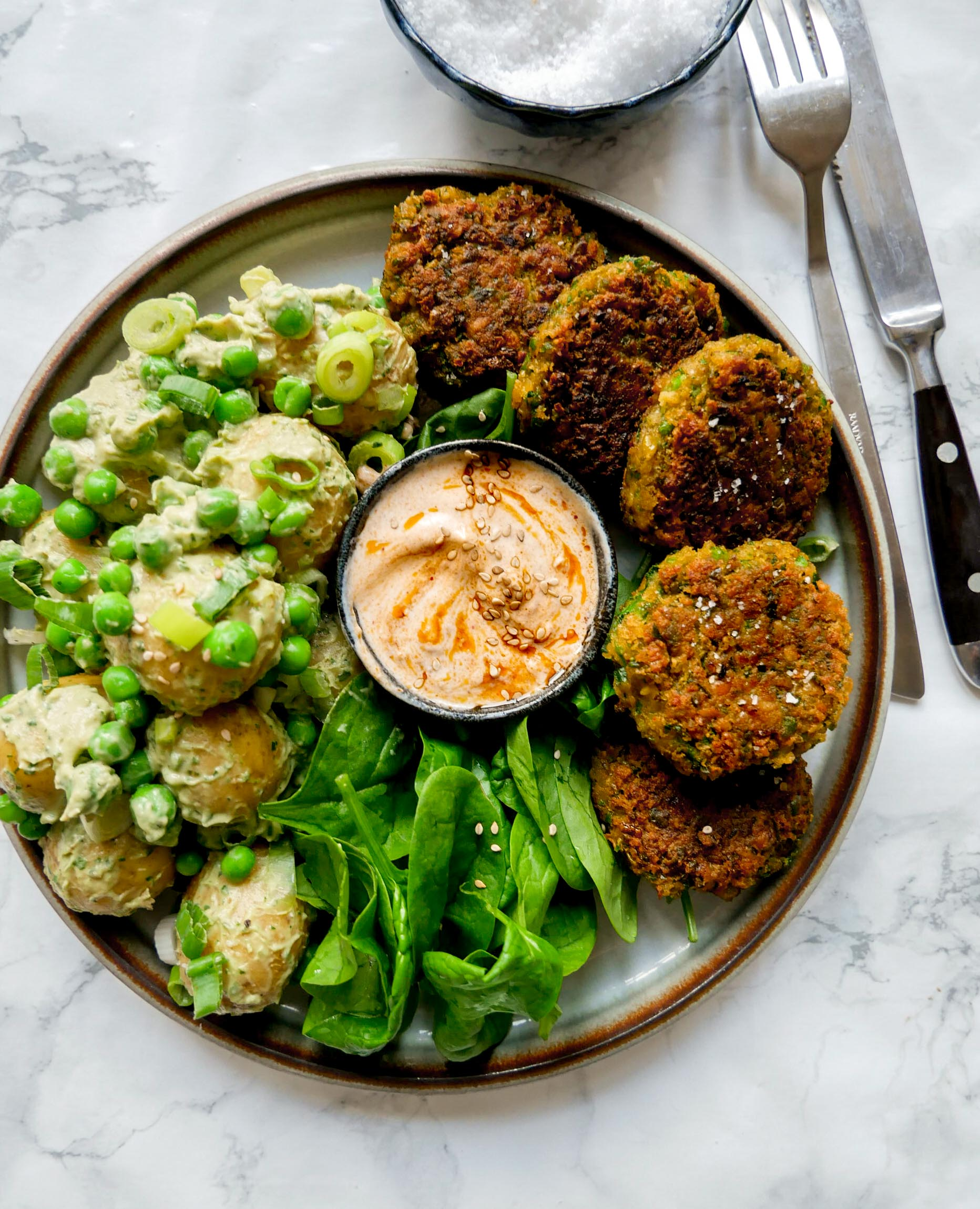 vegan bowls with potato salad and patty